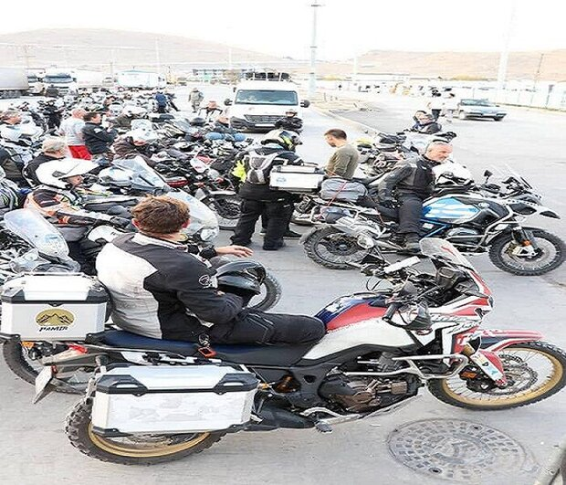 Cluster of French motorcyclists traversing Iran