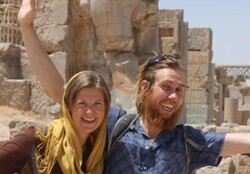 A Spanish couple poses for a photo during a visit to the UNESCO-registered Persepolis, which was once the ceremonial capital of the Persian Achaemenid Empire (c. 550–330 BC).