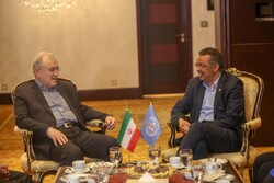 Iranian Health Minister Saeed Namaki (L) meets Director General of World Health Organization Tedros Adhanom Ghebreyesus