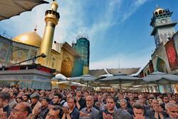 اقامه نماز ظهر در حرم امام علی (ع)
