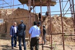 East Azarbaijan province's tourism chief Morteza Abdar (L) visits the ruins of Rab'-e Rashidi inspecting the third archaeological season of the 14th-century educational complex in Tabriz, northwest Iran.