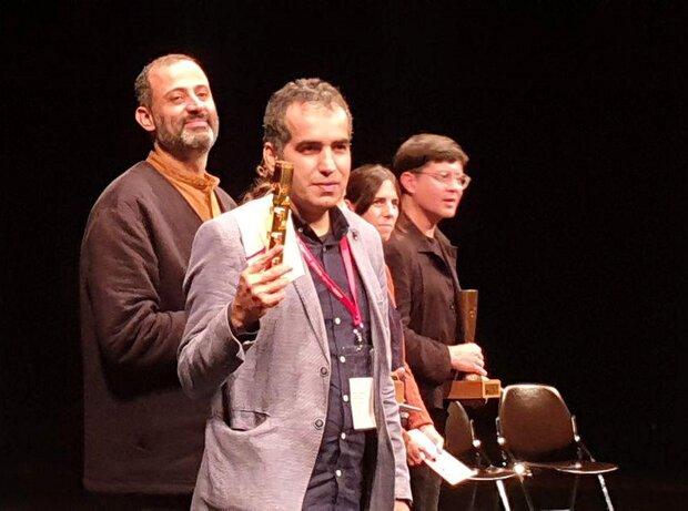 Iranian filmmakers Bahman Kiarostami (L) and Arash Es'haqi (C) accept their awards during the Yamagata International Documentary Film Festival in Japan on October 16, 2019.
