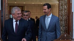 Syrian President Bashar al-Assad (R) welcomes a Russian delegation headed by the Kremlin's special envoy on Syria Alexander Lavrentiev (front L) in Damascus, Syria, October 18, 2019. (Photo by SANA)