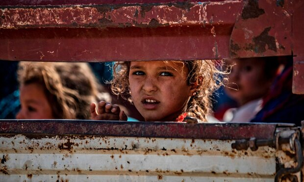 Civilians arrive inTall Tamr in the Syrian Hasakeh province on October 10, 2019 after fleeing the Turkish bombardment. (AFP/Delil Souleiman)