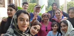 """David Robie (C) poses for a photo surrounded by """"friendly"""" Iranians who are """"keen for a chat, selfies and swapping Instagram accounts"""". (Credit: David Robie)"""