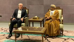 Iranian Minister of Cultural Heritage, Tourism and Handicrafts Ali Asghar Mounesan (L) talks to his Omani counterpart Ahmed bin Nasser al-Mahrizi in Muscat, October 21, 2019.