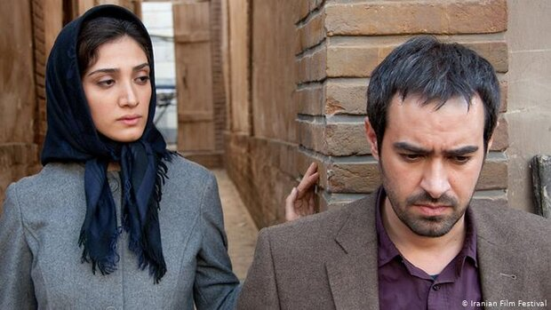 """Mina Sadati (L) and Shahab Hosseini act in a scene from """"The Paternal House""""."""