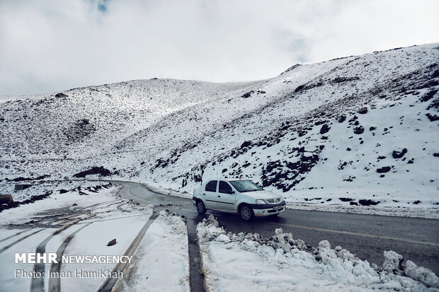 Snow whitens Hamedan's mountains