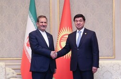 Iran's First Vice-President Es'haq Jahangiri (L) shakes hands with Kyrgyz Prime Minister Mukhammedkalyi Abylgaziev during his visit to Bishkek, November 1, 2019.