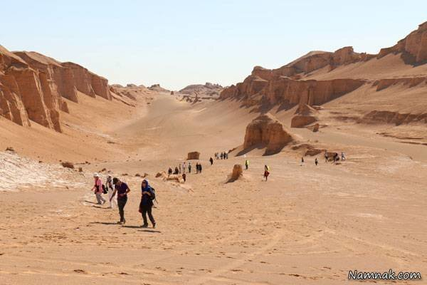People visit Shahdad, a touristic part of the UNESCO-registered Lut desert, in Iran's Kerman province.