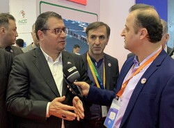 Iranian Industry, Mining and Trade Minister Reza Rahmani talks to the press after meeting with Shahin Mustafayev, Azerbaijan Republic's deputy prime minister, in Shanghai on Monday.