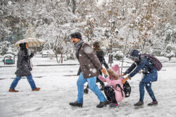 Tehraners welcome first autumn snow