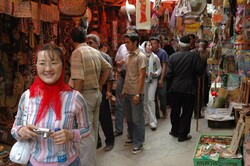 An undated photo shows a Chinese traveler (L) touring a bustling traditional bazaar during her visit to Iran.
