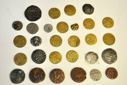 A file photo shows tens of ancient Iranian coins.
