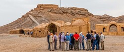 Foreign travelers visit the towers of silence nested on a lonely, barren hilltop on the outskirts of Yazd, central Iran.