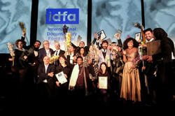 Winners celebrate after accepting their awards during the International Documentary Film Festival Amsterdam at the Eye Film Museum on November 28, 2019. (IDFA)