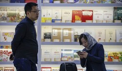 Representatives of a publisher from China as the guest of honor attend the 32nd Tehran International Book Fair on April 26, 2019. (Shafaqna)