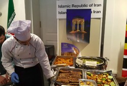 Iran's stall offers visitors traditional Persian dishes at a one-day charity exhibit in Ljubljana, the capital of Slovenia.