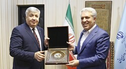 Iran's tourism minister Ali-Asghar Mounesan (R) meets with Uzbekistan's ambassador in Tehran Bakhodir Abdullaev at the Ministry of Cultural Heritage, Tourism and Handicrafts, December 3, 2019.