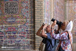 Foreign travelers take photos of the 19th-century Nasir al-Mulk Mosque, also known as the Pink Mosque, in Shiraz, southern Iran.