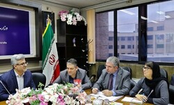 Iran's deputy tourism minister Vali Teymouri (1st L) and UNWTO advisor Marcello Notarianni (2nd R) exchange views on developing the country's comprehensive tourism plan in a Tehran meeting, December 7, 2019.