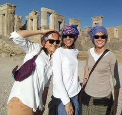 An undated photo shows foreign travelers posing for a photo in Persepolis, southern Iran.