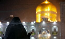 A woman prays during her visit to the holy shrine of Imam Reza (AS) in Mashhad.