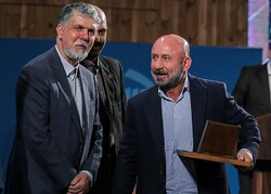 "Kazem Darabi (R) receives the award in the documentation category for his memoirs ""Teahouse Painting"" from Culture Minister Abbas Salehi (L) during the 12th Jalal Al-e Ahmad Literary Awards in Tehran"