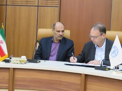 Gerold Bödeker, FAO Representative to Iran (R), Hossein Ali Abdolhay, deputy head of Iran Fisheries Organization.
