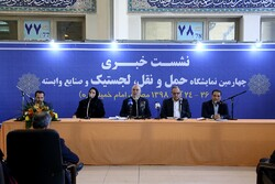 IKAC managing director Ali Rostami (R) speaks at the opening ceremony of the 4th International Exhibition of Transportation, Logistics and Related Industries at the Imam Khomeini Mosalla, December 15, 2019.