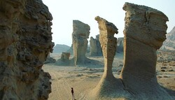 File photo depicts a man visiting giant Kaluts of Shahdad, a major part of the UNESCO-registered Lut desert, in Kerman province, southeastern Iran.