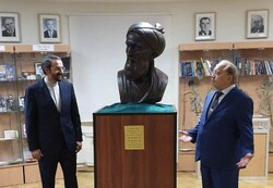 Iranian Ambassador Mehdi Sanai (L) and Lomonosov Moscow State University rector Victor Sadovnichy attend a meeting at the university in the Russian capital to unveil a bust of Persian poet Rudaki.