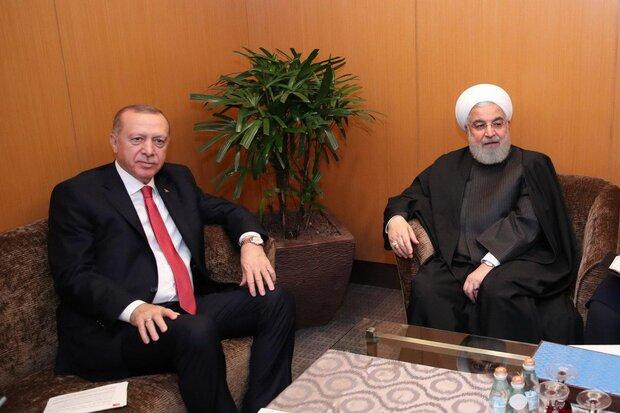 روحاني يلتقي بنظيره التركي في ماليزيا