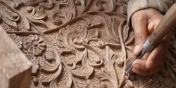 Malayer one step closer to 'a world city of woodcarving'