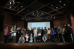 Winners and the organizers pose during the closing ceremony of the 6th Silver Cypress Exhibition at the Iranian Artists Forum in Tehran on December 20, 2019.