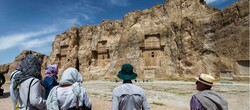 Travelers visit Naqsh-e Rostam, an Achaemenid-era rock-hewn necropolis in southern Iran