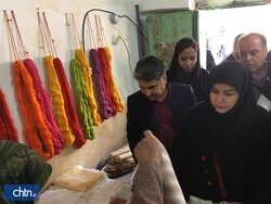 Cultural Heritage, Tourism and Handicrafts Deputy Minister Pouya Mahmoudian (front R) visits a crafts workshop in the village of Khorashad, northeast Iran, December 31, 2019.