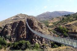 World's first curved glass suspension bridge inaugurated in Iran