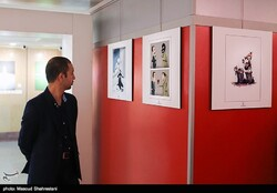 A man visits the End of Terrorism Art Competition exhibition at Tehran's Art Bureau on May 14, 2018. (Tasnim/Masud Shahrestani)