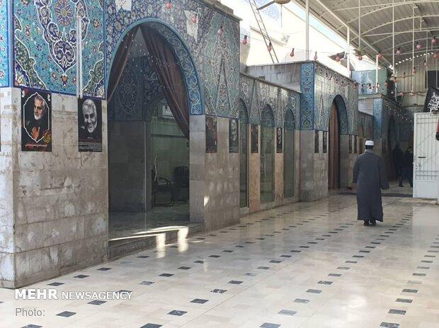 تصاویر فرمانده مدافعان حرم بر دیوارهای حرم زینب (س)