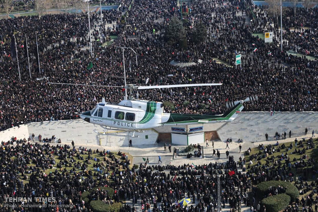 Packed crowds attend funeral procession of top military commander Qasem Soleimani in Tehran