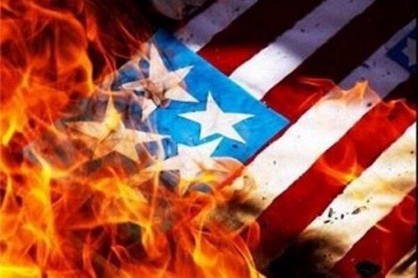 کرمانی عوام نے آزادی اسکوائر پر امریکی پرچم کو نذرآتش کردیا