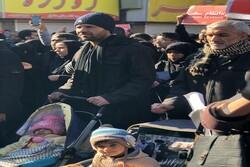 مواطنون يشاركون في مراسم دفن الشهيد الفريق قاسم سليماني