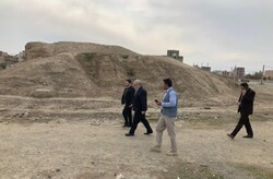Local officials, experts visit the historical Tepe Ahranjan in Salmas county, northwest Iran.