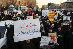 People gather in front of Iranian Parliament to ask expulsion of UK envoy