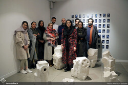 Nominees for the Vista Contemporary Art Prize pose with curator Parisa Pahlavan (4th L) at Tehran's Vista Gallery on January 11, 2020. (Honaronline/Mahdieh Babai)