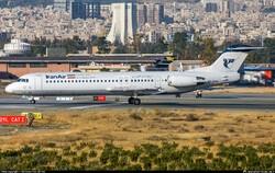 An Iran Air Fokker F100 is seen on the runway at the Mehrabad International Airport in western Tehran. (Photo credit: Mohammadreza Zeinloo)