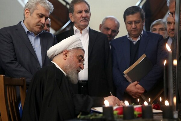 Pres. Rouhani signs memorial notebook for victims of Ukrainian plane incident