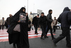 People gathering for Friday Prayers to be led by Ayatollah Khamenei