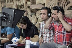 "Afghan brothers Jamshid (R) and Navid Mahmudi (2nd R) codirect a scene from the TV series ""The Parasol""."